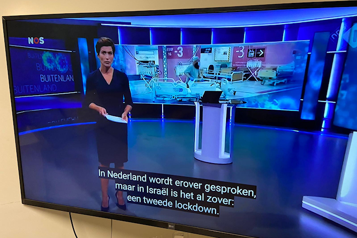 A Dutch news anchorwoman talks about Rambam Health Care Campus's opening of the Sammy Ofer Fortified Underground Emergency Hospital on the evening news in The Netherlands. Photography: Rambam HCC